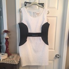 "Michael Kors Dress Size 12 in good condition. Little (not very visible) discoloration from black color under arm pits (see photo #3). Length just above the knee for 5'5"" women. Make me a reasonable offer!! MICHAEL Michael Kors Dresses Mini"