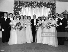 American concert singer and actress Jeanette Macdonald (1902 - 1965) poses with her husband Gene Raymond for a group wedding portrait. Many Hollywood celebrities are in attendance; from left to right, Nelson Eddy, Allan Jones, Helen Ferguson, Richard Hargreaves, Mrs Warren Rock (sister of bride), Robert Marlow (bridegroom's brother and best man), Jeanette Macdonald, Gene Raymond, Fay Wray, Harold Lloyd, Ginger Rogers, Warren Rock, Mrs & Mr John Mack Brown and Basil Rathbone. Original…