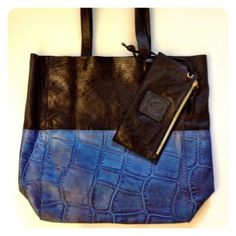 Top Handles soft Charlie tote is super light and chic to carry all of your days needs. Has a detachable pouch, raw supple suede inside without and lining, it feels so good to carry the charlie. Comes solid or two tone as shown.