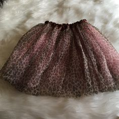 Leopard TuTu Cute pink, brown & black leopard tutu.  Worn once!  Elastic waist.  Easy fit!  2 layers of Pink voile lining.  100% Polyester Skirts Mini