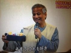Dr. Yunus is holding our Unagi Bus in his hand!