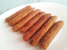 MERGUEZ 2 Tasses haricots rouges cuits 2/3 Tasse  farine de pois chiche 1/3 Tasse levure maltée  1.5 Tasse flocons d'avoine 1/3 Tasse quinoa 60g amandes effilées   4 cs purée de tomates  2cs huile de colza ou d'olive  2 cs sucre 1/2 Tasse d'eau 4cs harissa  1cc de chaque : coriandre moulue, ail en poudre, cumin moulu, paprika 2cc sel