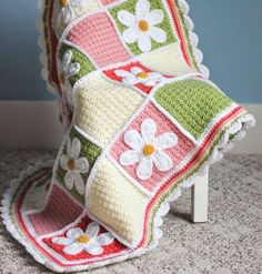 Darling Daisy Crochet Baby Blanket | Perfect for a youngster's room, this crochet blanket will remind you of spring all year round!