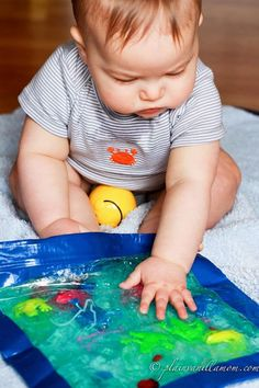 Make sensory bags for baby using gallon ziplocks, fun duct tape, clear hair gel, food coloring, glitter, nonsharp toys.
