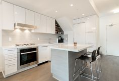 Fairview/Kitsilano Apartment for sale at The RADIUS 1 bedroom with 2 spacious Patios! Small White Kitchens, Cool Kitchens, Latest Kitchen Trends, Small Kitchen Renovations, Engineered Wood Floors, Modern Kitchen Cabinets, Kitchen Photos, Apartments For Sale, Image House