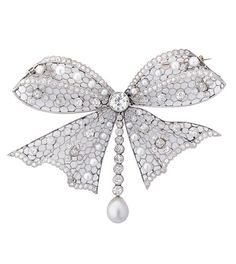 DIAMOND PEARL AND PLATINUM BROOCH  An archetypal Edwardian platinum bow brooch, comprising of 20 natural pearls and approximately 5cts of diamonds, including the principal round stone in the centre, weighing 0.7cts. Circa 1910. In a fitted box.