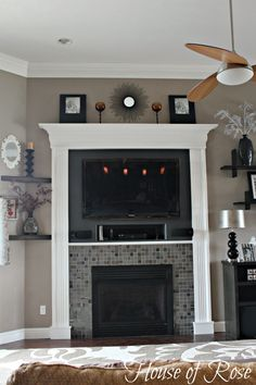 (Another FP mantle ontop of existing one , might give same look) fireplace makeover - love the built in dvd player nook