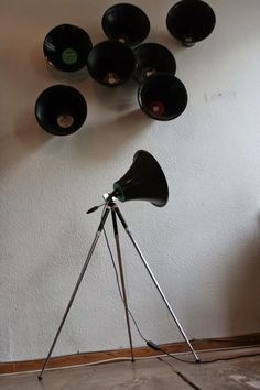 A Clever Upcycled Lamp Made Out of an Old Vinyl Record and a Camera Tripod
