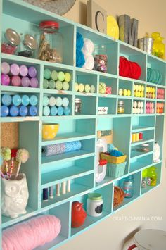 DIY Craft Cubby Wall. Good use of color.