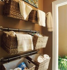 Baskets hanging from towel rods. Looks great! This might be good in the bathroom? crafty-things
