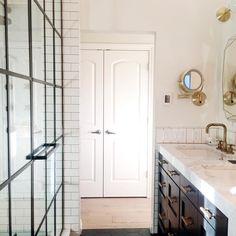 Bathroom design by Reena Sotropa In House Design Group #calgarydesigner #interiordesigner #interiors #designer #yycdesigner #residentialdesign #bathroomdesign #bathroomfixtures #bathroom #ensuite #shower #showerdoor #showerframeddoor #brassbathroom #marble #tile