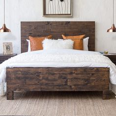 This Queen size rustic slatted bed base is manufactured from solid reclaimed wood. Gleaming with character it is the ideal choice for the sustainability conscious buyer. With its dark stained wood and parquet design panels, the Campbell bed base brings a lovely cottage feel to any