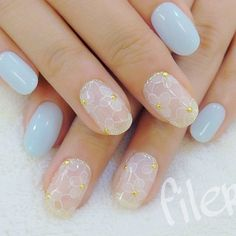 As much as there are ridiculously grand nail art styles, simple can also still be beautiful. Paint your nails in clear white acrylic and baby blue colors while accentuating it with gold beads posing in the center of the flower petals. This style is perfect for everyday activities and can match your outfit wherever you may need to go.