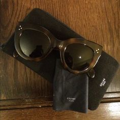 "Celine Caty Sunglasses Havana Preowned Celine ""Caty"" sunglasses . Style 41050 in Havana frame with dark grey/green lenses. Only sign of wear is at the tips of the arms as shown in the last photo. Comes with case and lens cloth.**just dropped the price as a corner of the case is damaged, but still in working condition.** Celine Accessories Sunglasses"