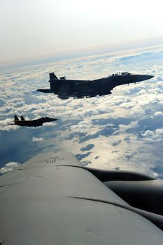 11/18/2013 - Two F-15E Strike Eagles fly alongside a KC-135R Stratotanker during Exercise Razor Talon, Nov. 15, 2013. Razor Talon is a massive air-sea exercise conducted at Seymour Johnson Air Force Base, N.C., monthly, which combines resources from multiple units along the East Coast to refine skills and promote joint-service cohesiveness. (U.S. Air Force photo by Airman 1st Class Brittain Crolley/Released)