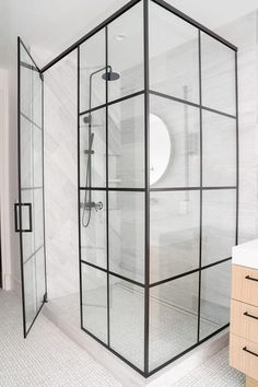 A black steel shower enclosure surrounds a walk-in shower boasting white and gray maze floor tiles and gray marble diamond pattern surround tiles. Quadrant Shower Enclosures, Frameless Shower Enclosures, Frameless Shower Doors, Framed Shower Door, Glass Shower Doors, Black Shower, Large Shower, Black Tile Bathrooms, Chic Bathrooms