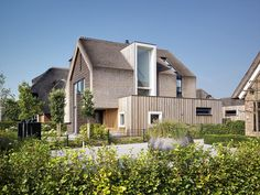This residential villa in Arnhem in the Netherlands showcases a traditional solution for modern day living. The authentic thatched roof covers both the roof and the facade. It required a flexible daylight solution. The owner choose FAKRO roofwindows t Thatched House, Thatched Roof, Modern Barn House, Fibreglass Roof, Natural Homes, Beautiful Villas, Wooden House, House Roof, Ramen