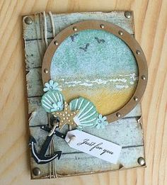 handmade card from the WOW! Embossing Powder Blog: Life's A Beach ... porthole with heat embossed sand, sea and sky ... die cut shells and anchor ... twine and brass brads ... aged look ... luv it!