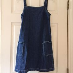 Denim Dress by Donna Karan DKNY Jeans Cotton and 2% spandex for a little stretch - great denim sundress that easily goes into fall with a sweater and leggings or a long-sleeve tee! Two pockets, zips up the back. Above the knee. Cute and fun! DKNY Dresses