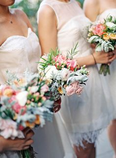 White Bridesmaids Dresses with Colorful Bouquets