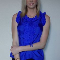 Cobalt Blue 100% Silk Front Ruffle Top Pictures do not do this beautiful blue sleeveless silk blouse justice! Front ruffles and a thin silk bow. Side zipper. Back keyhole button loop closure. Flawless condition, freshly dry-cleaned. Looks cute with a cropped black leather jacket! Purchased at Nordstrom. Filtre Tops Blouses