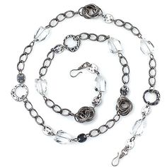 SEPHIRA Item #: USML100034 This fun chunky necklace uses antique silver and a mix of clear glass beads and funky silver hoops that can be worn alone for a touch of spunk or layered for a bit of more attitude. Measures 42 inches. Your Price:	$58.00