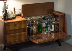 """Drank half an inch of every spirit in my parents' drinks cabinet, including several weird European ones that no one has touched in 15 years"" drunk. Home Bar Cabinet, Drinks Cabinet, Liquor Cabinet, Vintage Stereo Cabinet, Bookshelf Bar, 70s Decor, Home Bar Decor, Vintage Bar, Vintage Interiors"