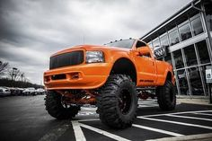 Orange Lifted Ford with Big Mud Tires - YES!