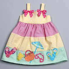 A textured checkered print in vibrant colors of yellow, pink and green highlight this adorable dress from Good Lad.
