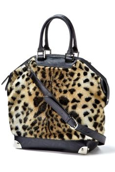 "This Fabulous Furs Leopard bag comes with double zip pulls, silver hardware and an optional adjustable shoulder strap to clip on/off. This is a great bag and has a very smart look with any outfit.     Measures: 15"" x 17"" x 11""' 6"" handle drop; 45"" strap    Leopard Bowler Bag by Locust Whimsy. Bags - Totes New Jersey"