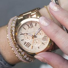 Rose gold love. Sparkle mani + luxe stacked wrist.