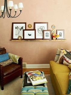 An expansive floating shelf adds character to a blank wall. Layer framed prints or pictures and favorite accessories along the shelf. If you have a larger wall, hang several shelves and stagger their heights.