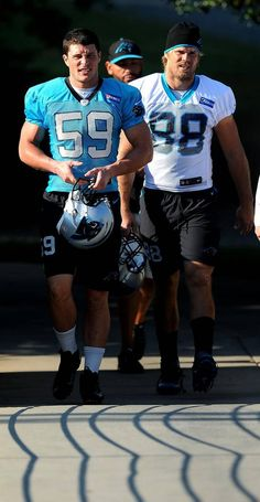 Carolina Panthers linebacker Luke Kuechly, left, and tight end Greg Olsen, right, walk to practice on Tuesday, September 1, 2015.