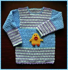 Blue crochet sweater with duck Momo.