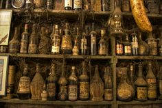 I'd love to have vintage bottles and shelving like this. Perfect adeptation of a 'pirate bar'. Just probably not all the cobwebs, though they do look pretty awesome.
