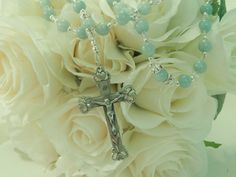 Mint Bridal Rosary •	Decade and Our Father beads gorgeous Semi-Precious Mint hued Aquamarine Gemstones (8mm) •	Our Father beads accented with Swarovski Clear Crystal Roundelles •	Sterling Silver and Swarovski Xillion Cut Clear Crystals beautifully sprinkled throughout compliment the beauty of this piece •	This Piece is shown with the stunning Heart Sterling Silver Crucifix and Center
