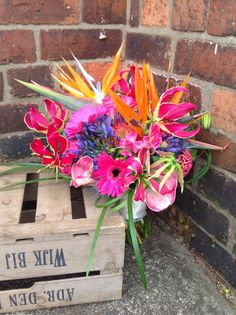 Bright Multi-Coloured Wedding Bouquet!Something a little brighter featuring the Gloriosa Lily! By The Greenery.  http://thegreenery.uk.com/