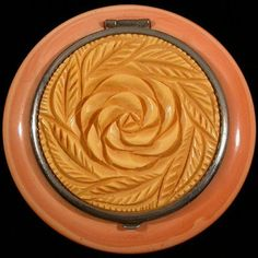 This Bakelite compact was probably made in France in the late 1920s