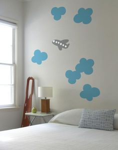 Cloud by Blik wall decals comes with 6 puffy clouds and a happy plane. Arrange on a wall and let the daydreams begin.