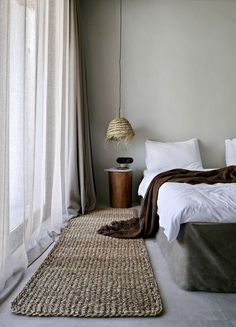 Calm and neutral bedroom design with woven lampshade