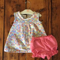 Check out our one of a kind, handmade dress with matching bloomers!