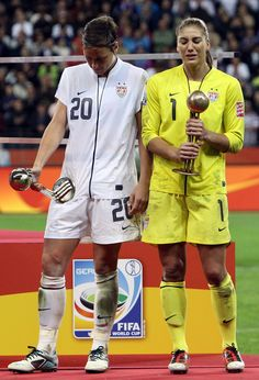 Hope Solo and Abby Wambach after the loss to Japan in the 2011 Women's World Cup. (Martin Rose/Getty Images)