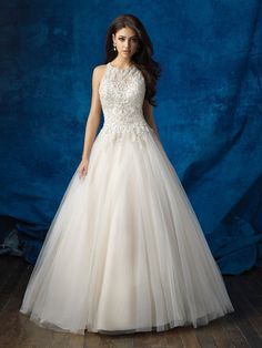 This regal ballgown features a high neck and elegant beadwork // Allure Bridals 9359