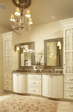 Amazing vanity--how grand!  I love the symmetry here.  So much storage space--sharing with sisters wouldn't be so traumatic!  Lovely chandelier lends ambient light while the overhead can lights add to it as well.  Sconces on either side of mirror helps to light the face.