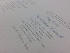 Gorgeous wedding invitations on thick, specialty paper. Blue, cursive lettering on a white background.
