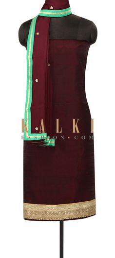 Wine unstithced suit with embroidered hem line only on Kalki