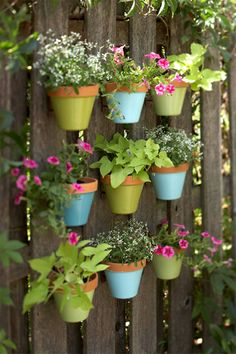 DIY Painted Pots Fence Garden- could hang pots on Garden posts @Kris Ritter