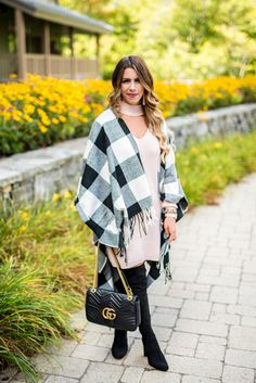 Bailey Schwartz shares a chic fall outfit featuring a cozy pink sweater dress and stylish buffalo check scarf from her trip to Stowe Mountain Lodge.