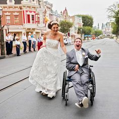 Disneyland Cast Members lined Main Street, U.S.A. to wave and cheer goodbye to the happy couple as they left their portrait session to begin their happily ever after.