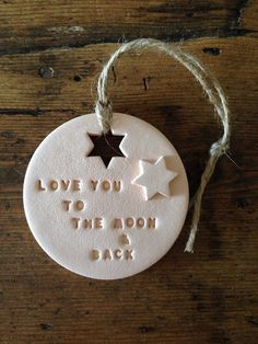 A lovely decoration made from air drying clay. Great nursery decoration, makes a lovely new baby gift, baby shower gift or a thoughtful present for Valentines or Mothers Day. The decoration is hand-stamped and hung with natural twine. It measures 7cm (2 3/4 inches) across. The colour is a blush (peach/pink). It will be beautifully gift wrapped in a box as shown (box colour may vary). Why not create your own unique gift by personalising a clay decoration with the message of your choice: h...